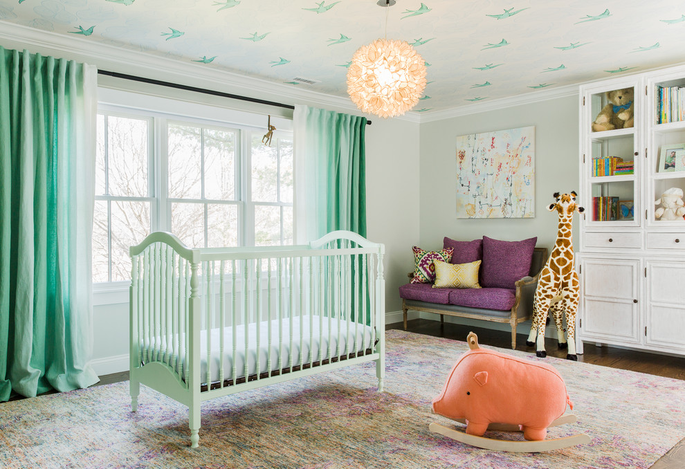 Example of a transitional gender-neutral dark wood floor nursery design in Boston with gray walls