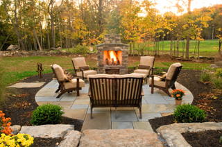 Small outdoor fireplace with round patio in front. (Fall setting.)