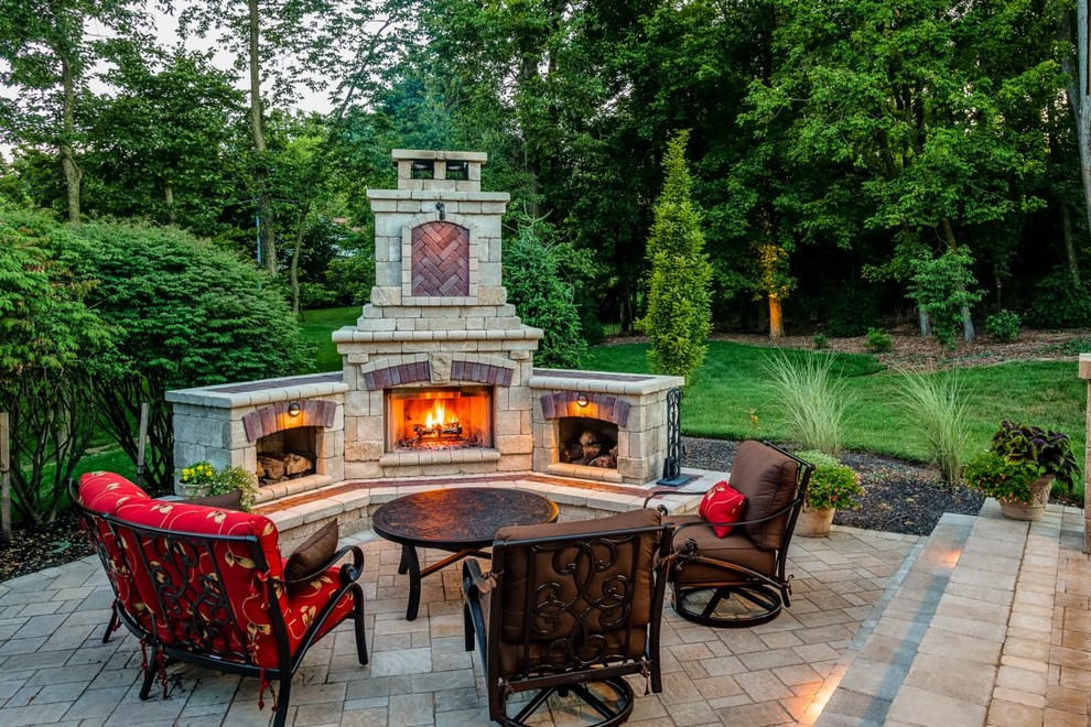 Example of a classic brick patio design in Other with a fire pit