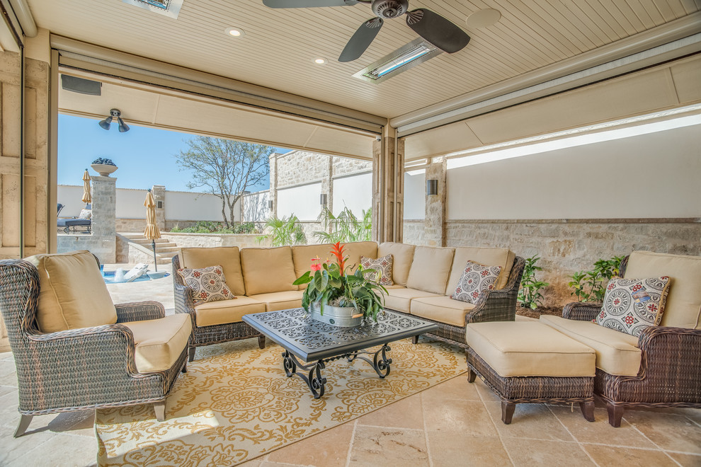 Example of a mid-sized classic backyard tile patio design in Austin with a roof extension