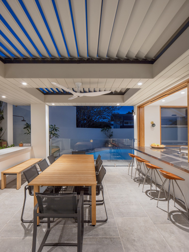 Inspiration for a contemporary backyard patio in Sydney with an outdoor kitchen.