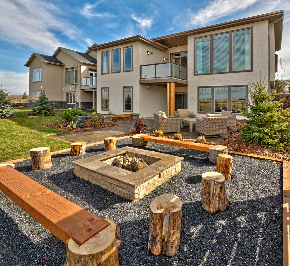 Patio - mid-sized contemporary backyard gravel patio idea in Other with a fire pit and no cover