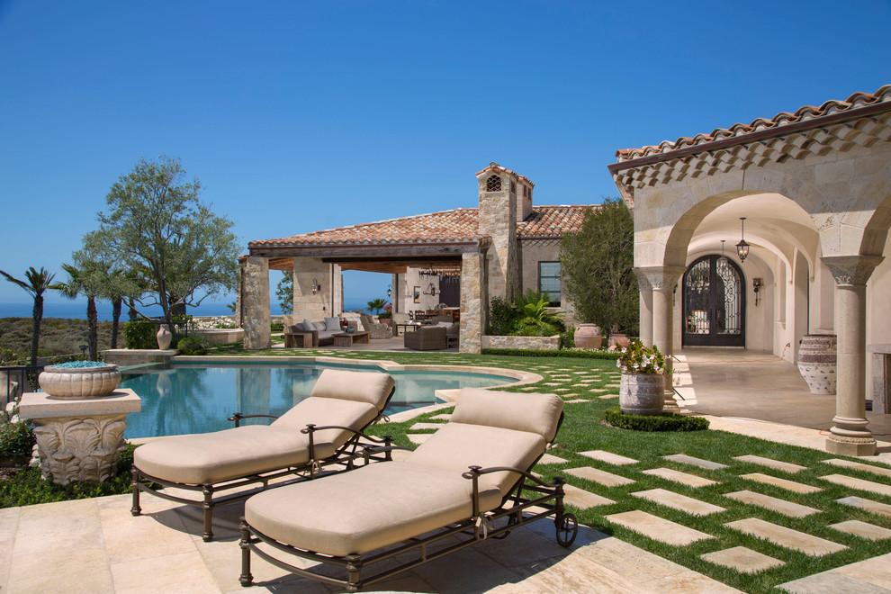 Patio - mediterranean patio idea in Orange County with no cover