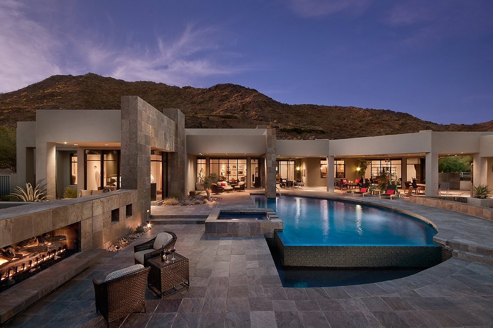 Patio - southwestern patio idea in Phoenix with a fire pit