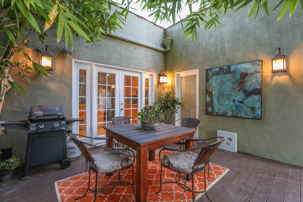 Tuscan patio photo in Los Angeles with decking