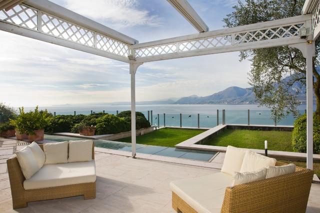 A couple of contemporary residential villas in Italy on Garda Lake mediterranean-patio