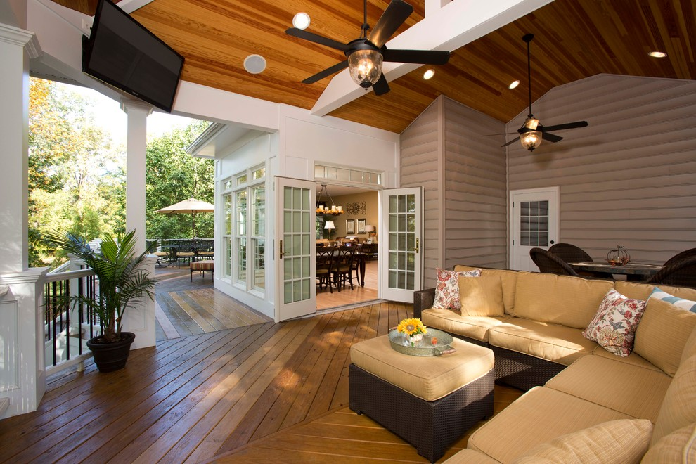 Patio - large traditional backyard patio idea in DC Metro with decking and a roof extension