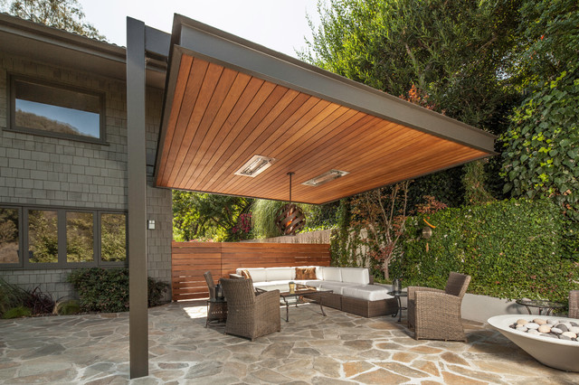 Inspiration for a contemporary patio in Los Angeles with a fire feature.