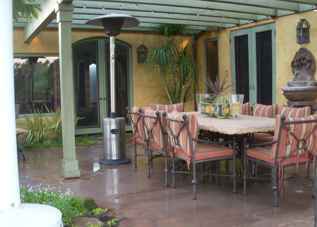Adding pergola and fountain help define patio for Garden room definition