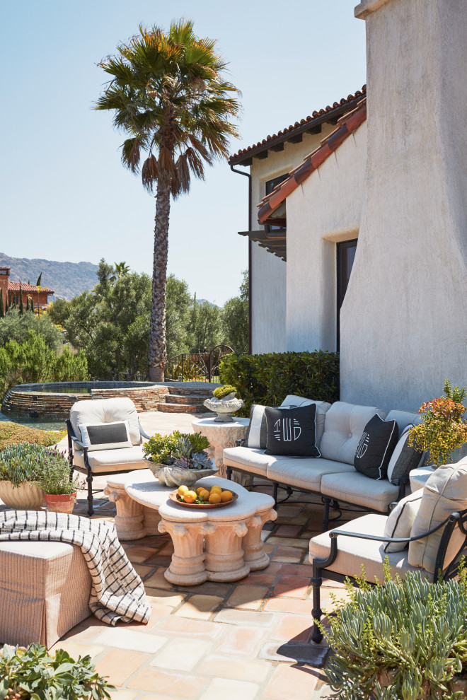 Mid-sized tuscan backyard tile patio photo in Los Angeles with no cover