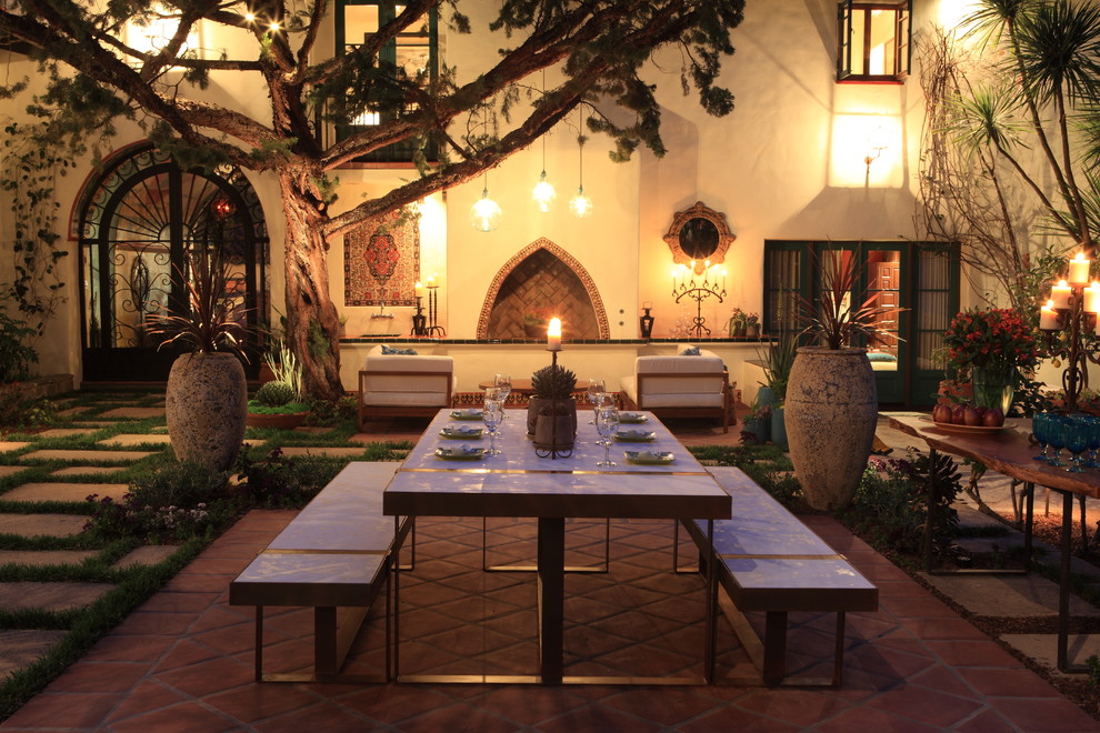 Example of a tuscan courtyard patio design in Los Angeles with a fire pit