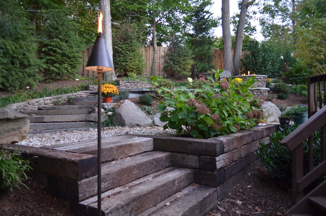 alexandria sloped yard raised patio fire pit water feature. Black Bedroom Furniture Sets. Home Design Ideas