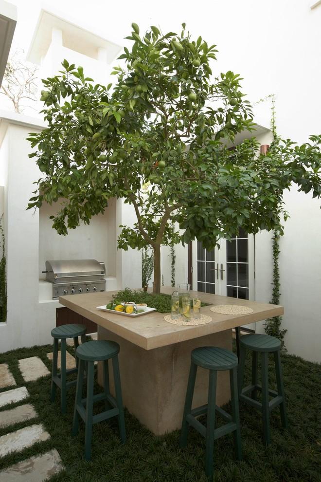 Tuscan courtyard patio photo in Miami