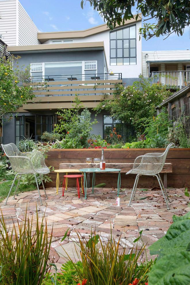 Patio - eclectic backyard brick patio idea in San Francisco with no cover