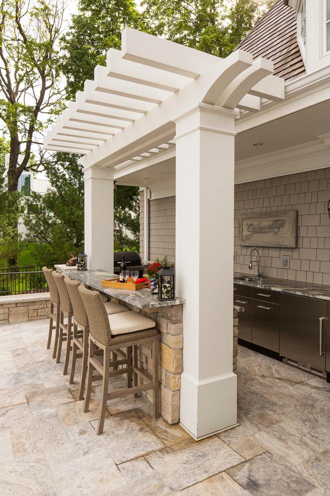 Patio kitchen - large traditional backyard patio kitchen idea in Minneapolis with a pergola