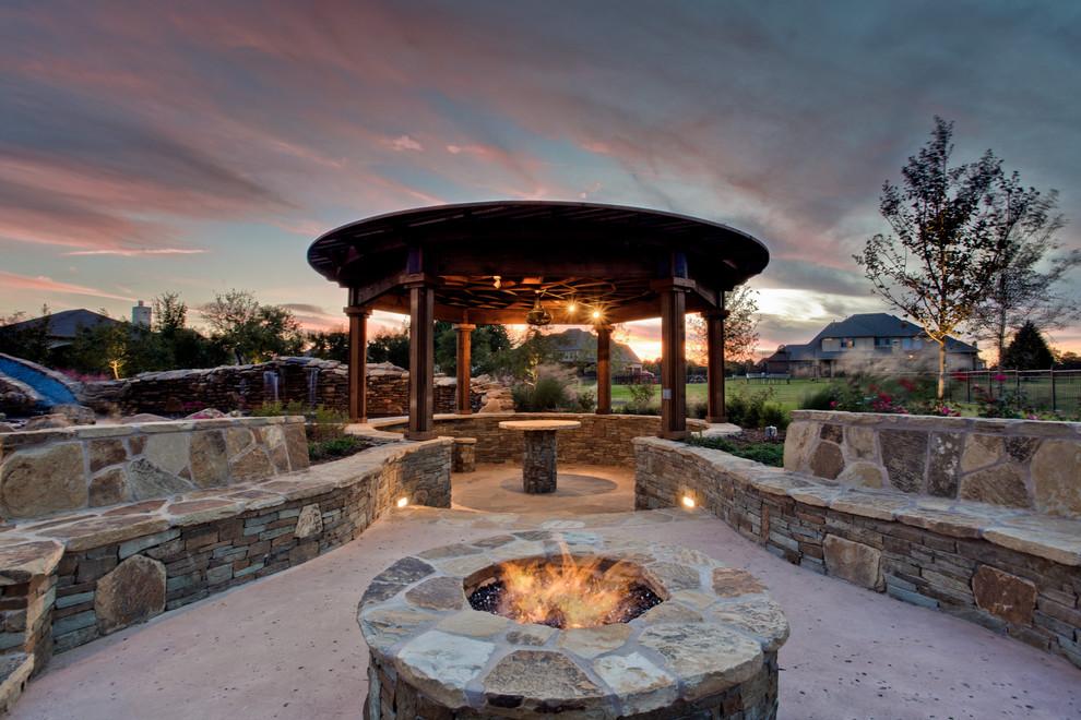 Patio - tropical backyard patio idea in Dallas with a fire pit