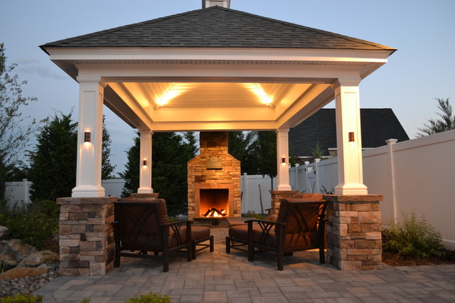 At The Edge Of A Patio, Beside A Lovely Shingle Roof Gazebo/pavilion