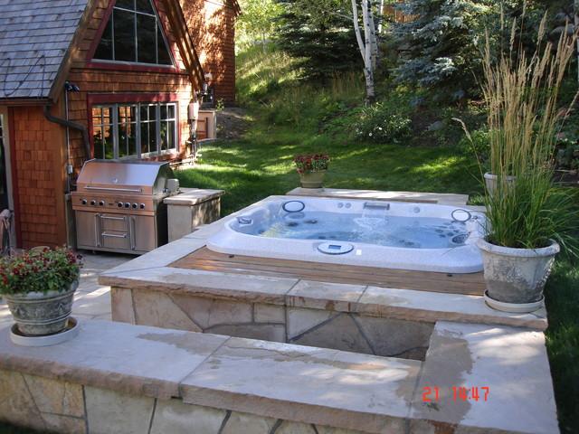 Award winning jacuzzi installations mediterranean for Jacuzzi spa exterior