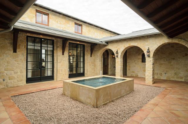 Award winning Lake Travis residence rustic-patio