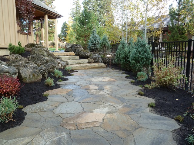 Patio - traditional concrete paver patio idea in Other