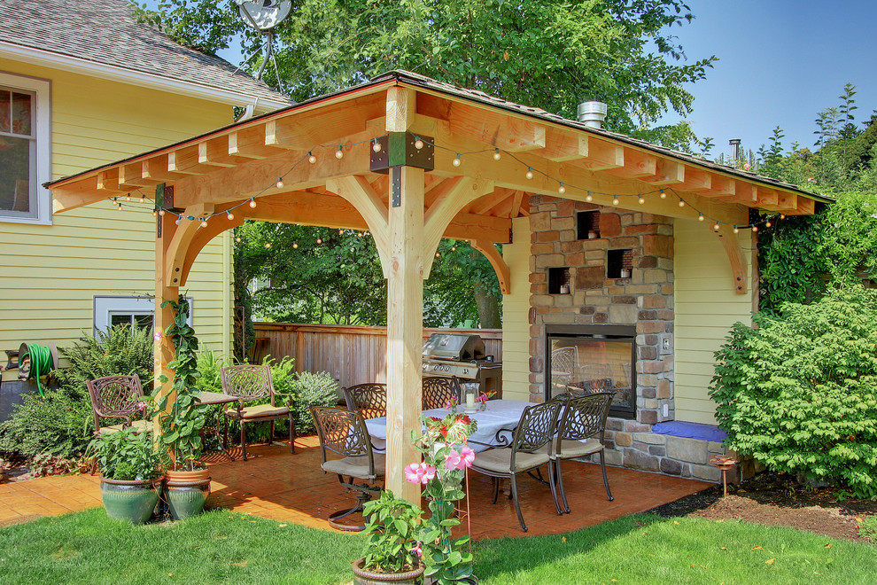 Trendy patio photo in Seattle with a gazebo and a fire pit
