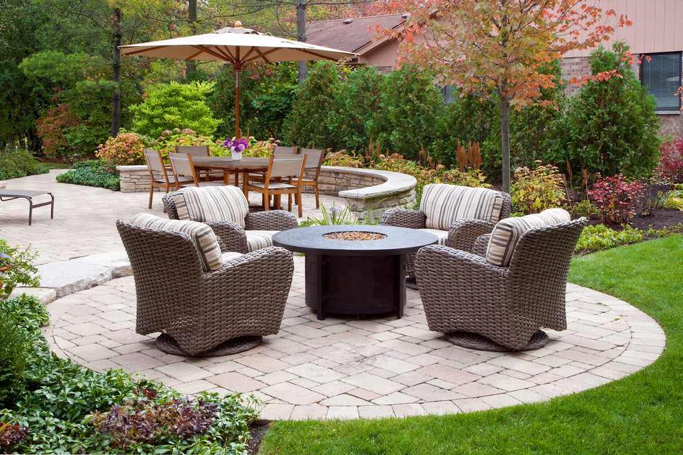 Inspiration for a timeless concrete paver patio remodel in Chicago with a fire pit