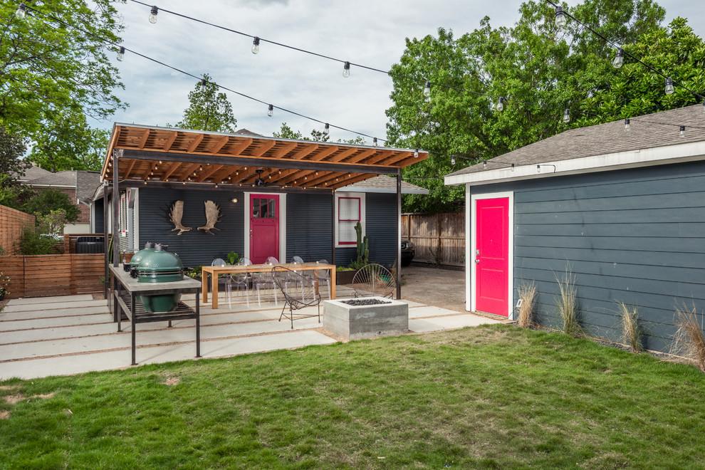 Trendy backyard concrete paver patio photo in Houston with a pergola