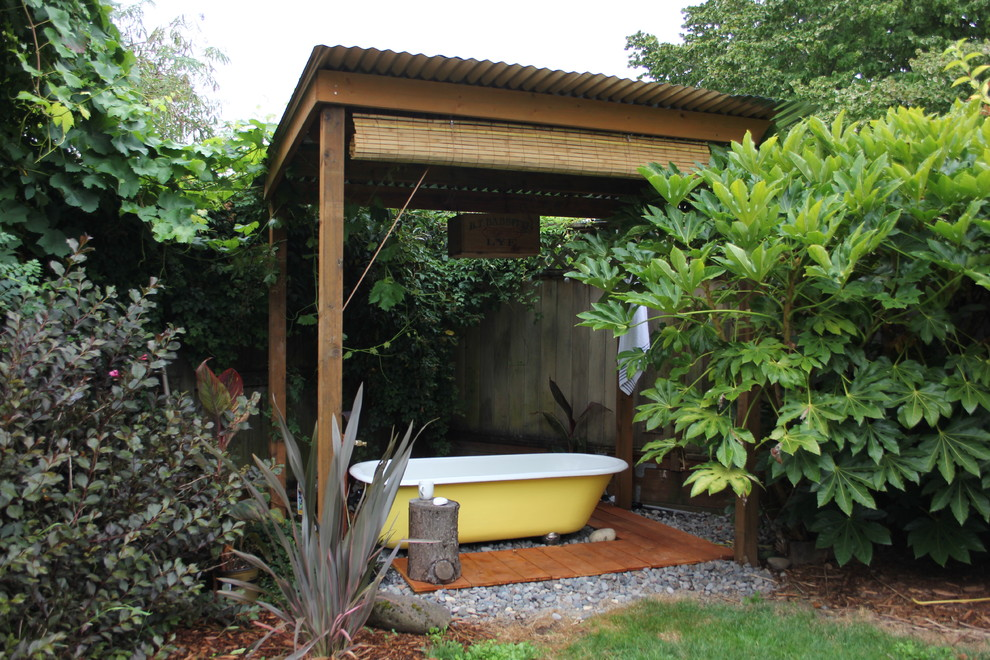 Inspiration for an eclectic patio remodel in Portland with decking