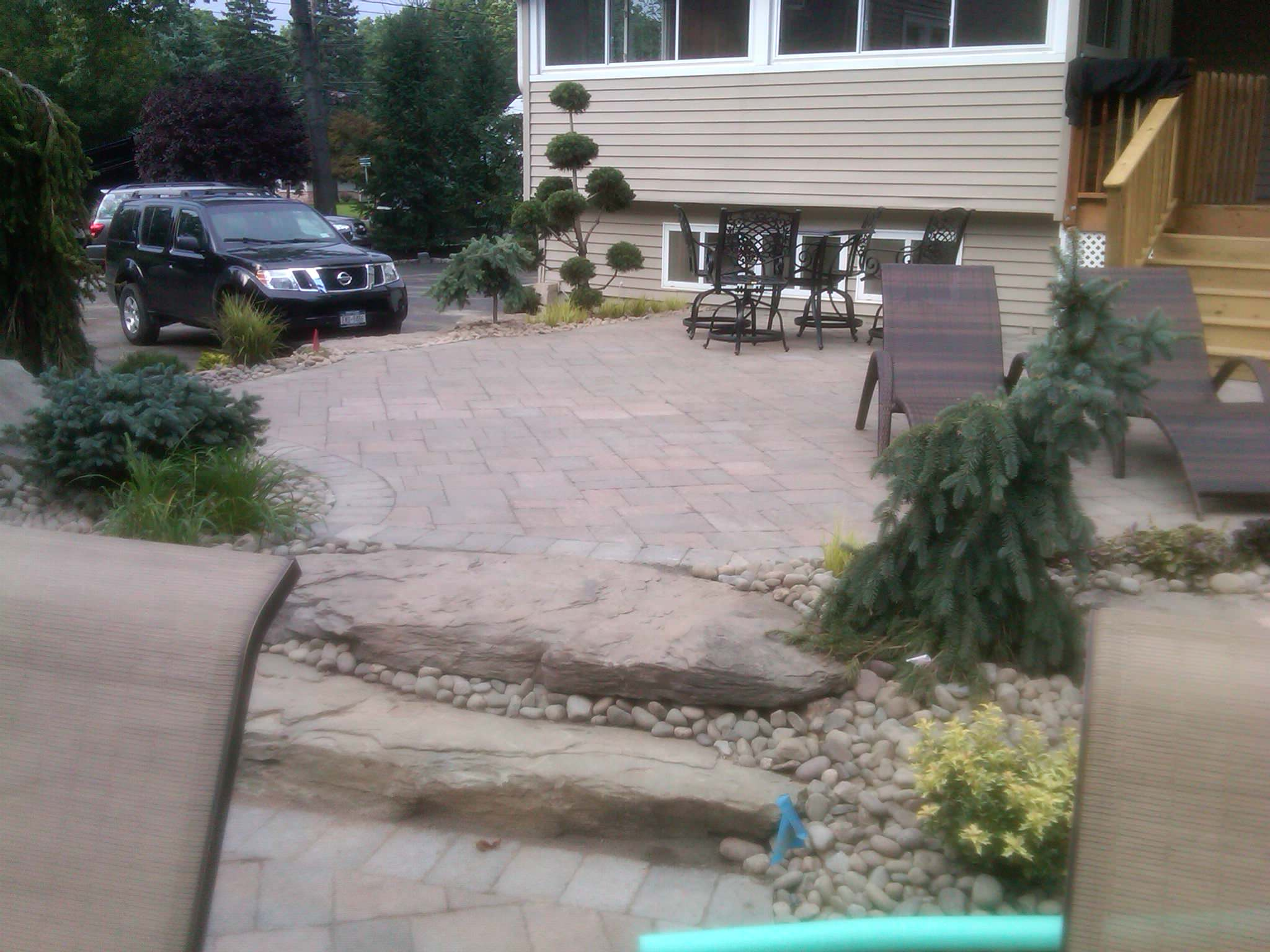 backyard landscape 'firepit''waterfall'tiered patio's pool with bluestone coping