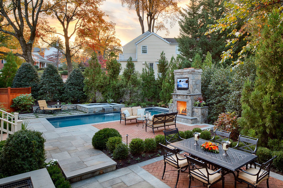 Patio - traditional backyard brick patio idea in DC Metro with a fireplace