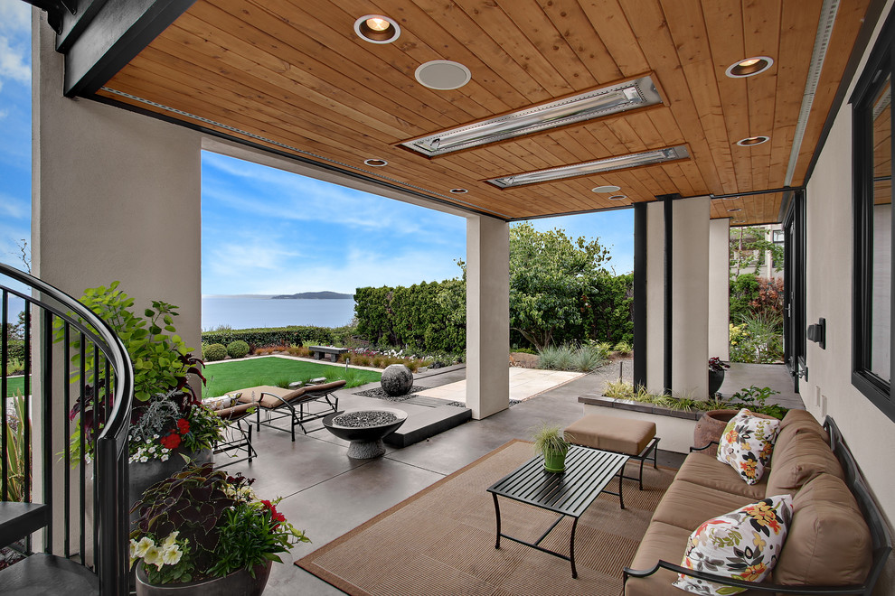 Transitional patio photo in Seattle with a fire pit