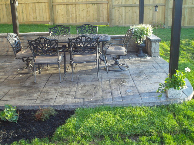 Backyard Patio with Poured Concrete Retaining Wall