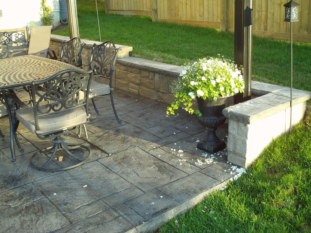 Backyard Patio With Poured Concrete Retaining Wall American