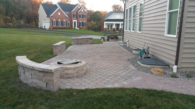 backyard patio with steps sitting walls firepit and sidewalk
