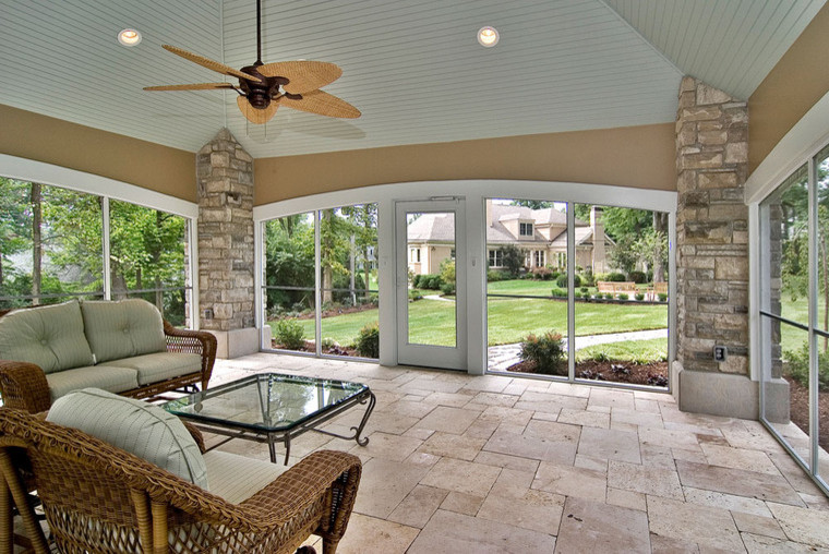 Large trendy backyard stone patio photo in St Louis with a gazebo