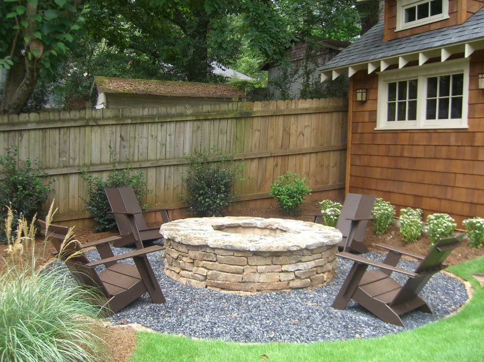 Example of an arts and crafts gravel patio design in Atlanta with a fire pit and no cover