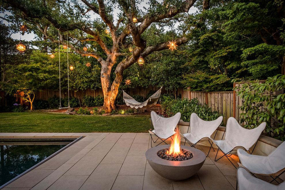 Tuscan backyard patio photo in San Francisco with a fire pit and no cover