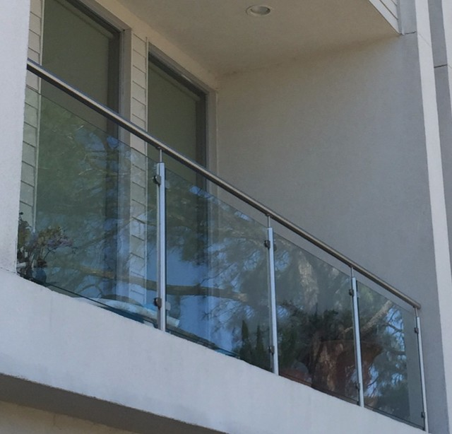 Balcony glass railing modern patio houston by for Balcony glass railing designs pictures