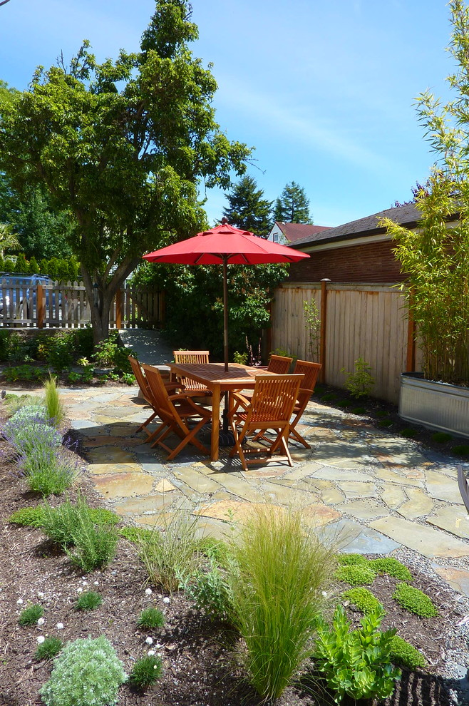 Example of a classic stone patio design in Seattle