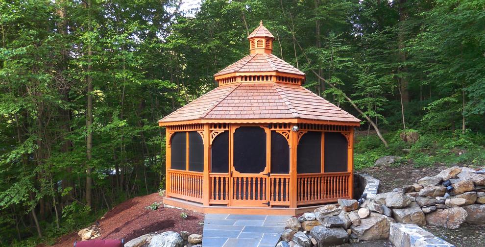 Patio - mid-sized traditional backyard stone patio idea in New York with a gazebo