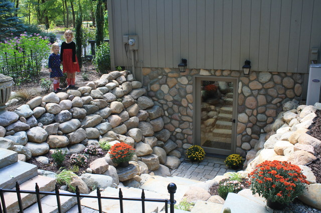 Basement walkout milford michigan traditional patio Walkout basement landscaping pictures