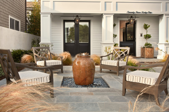 Example Of A Coastal Front Yard Patio Fountain Design In Orange County