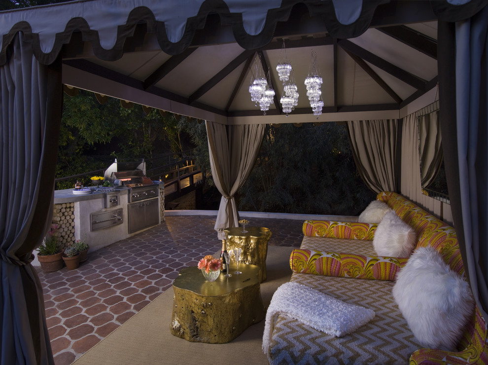 Example of a tuscan tile patio design in Los Angeles