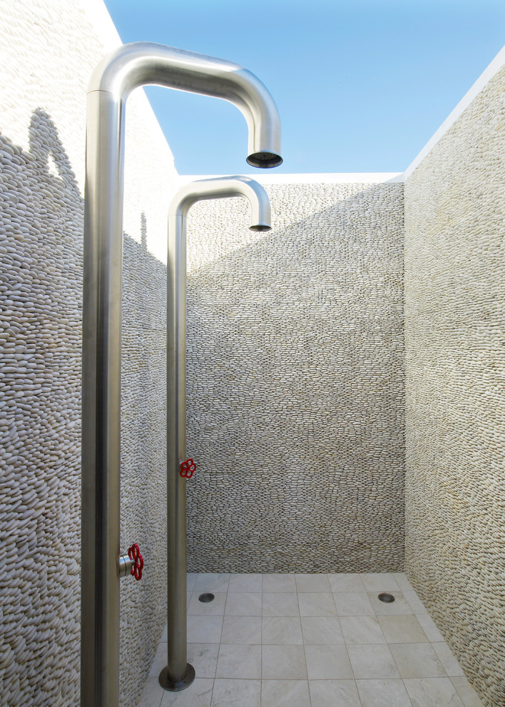 Example of a beach style outdoor patio shower design in New York
