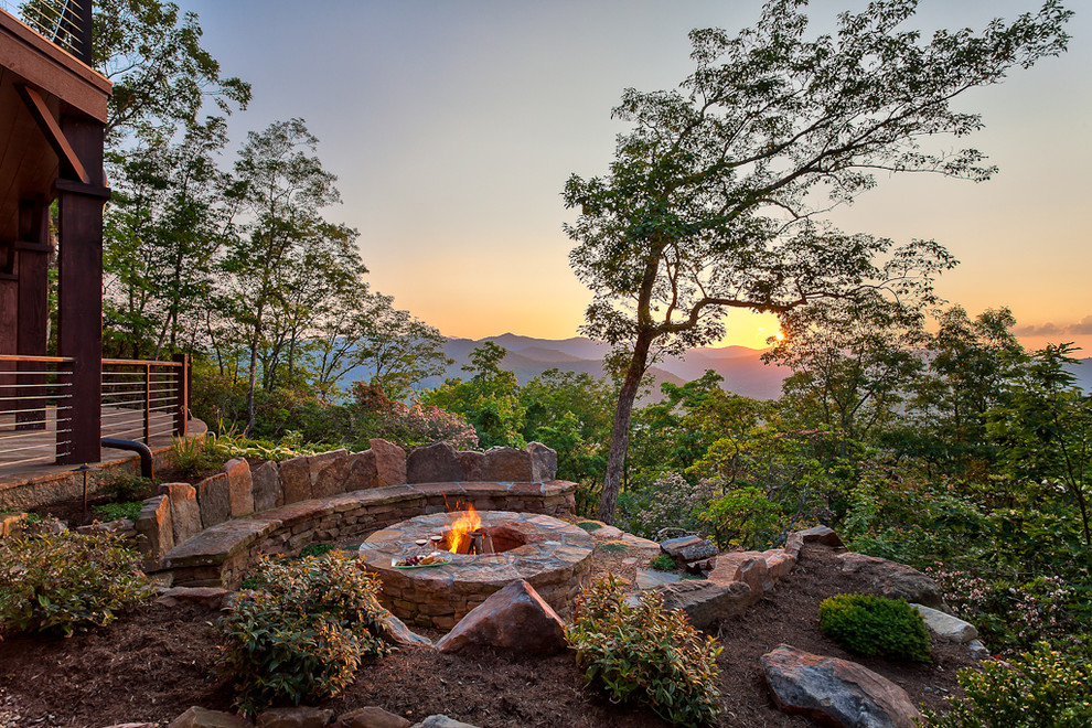 Example of a classic patio design in Other with a fire pit