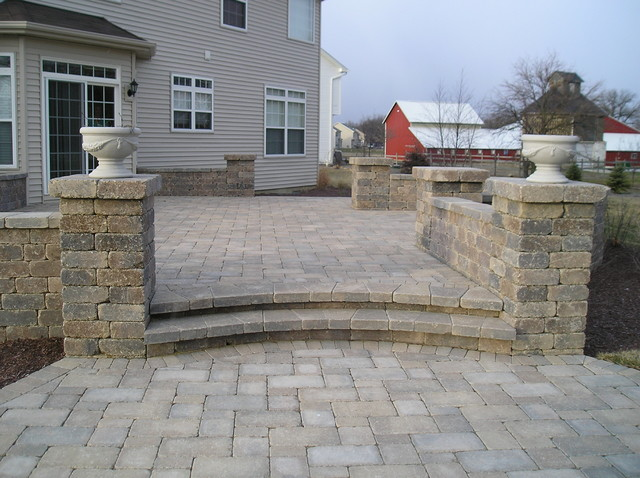 Belgard Patio With Stone Wall Traditional Patio