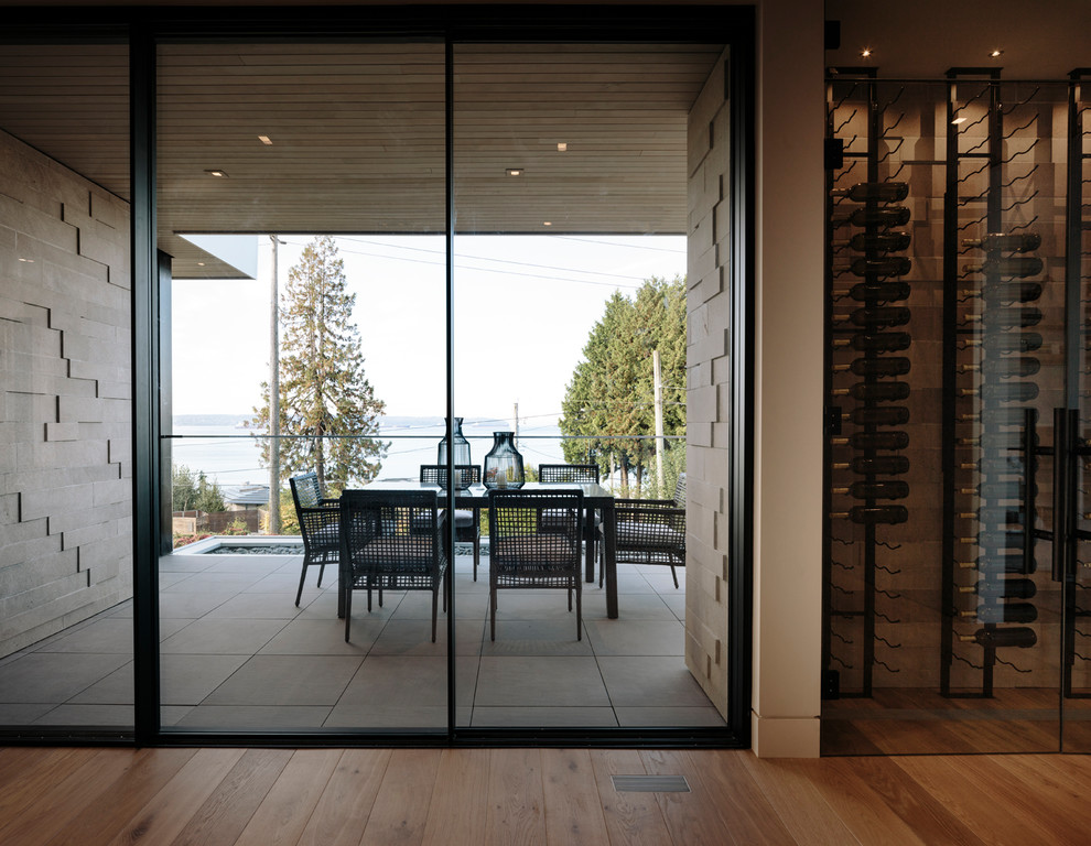 Large trendy front yard tile patio photo in Vancouver with a roof extension