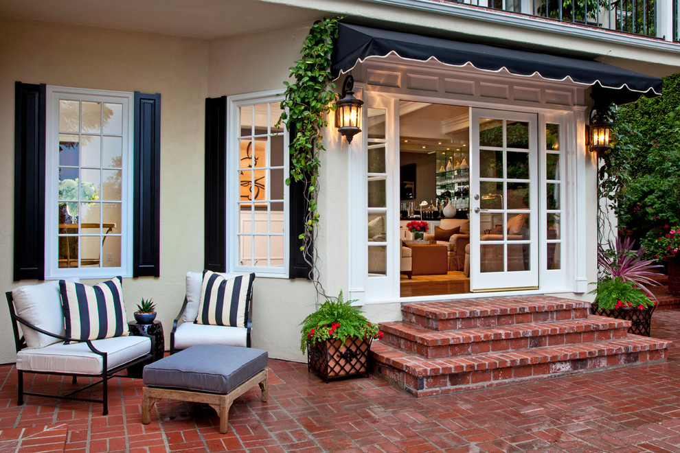 Transitional brick patio photo in Los Angeles