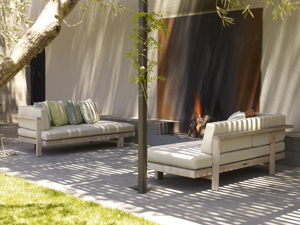 Inspiration for a modern patio remodel in San Francisco with a fire pit