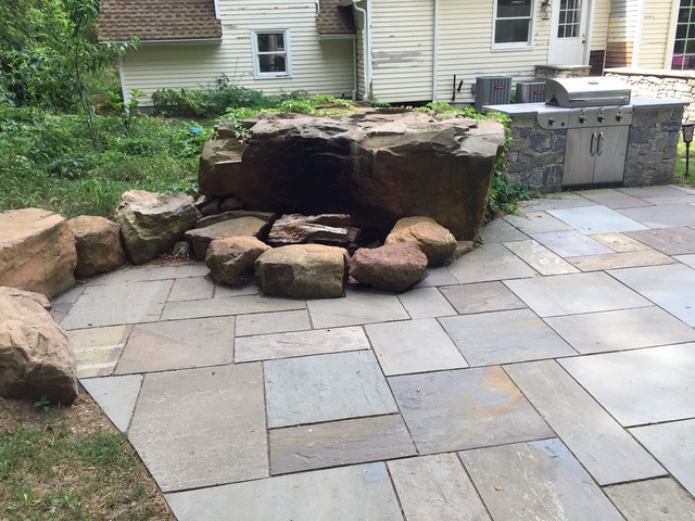 Inspiration for a timeless backyard patio kitchen remodel in Boston
